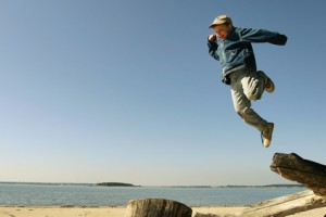 jumping boy on the spring beach